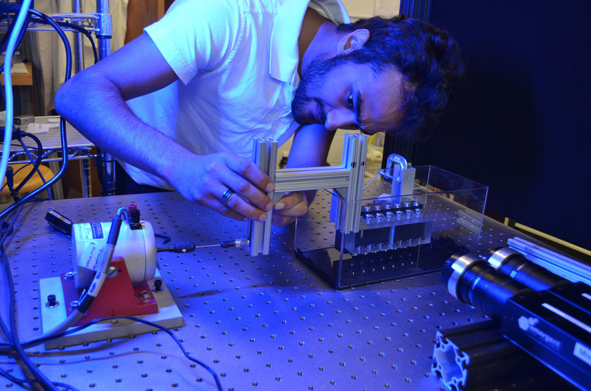 Ibrahim Mohammad adjusts the laboratory model he built.