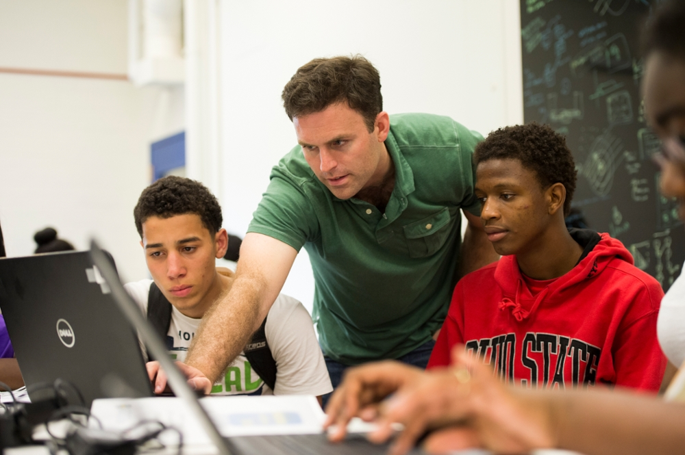 Thomas Howard, assistant professor assists students as part of the Upward Bound program.
