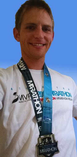 Image of Kenneth Goodfellow wearing marathon medal